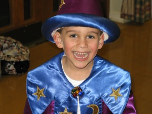 boy wizard in a wizard and witches themed kids party